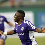 Louisville FC's Kadeem Dacres (7) celebrates after scoring against Toronto FC in May at Louisville Slugger Field