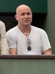 Andre Agassi watches Novak Djokovic's match against