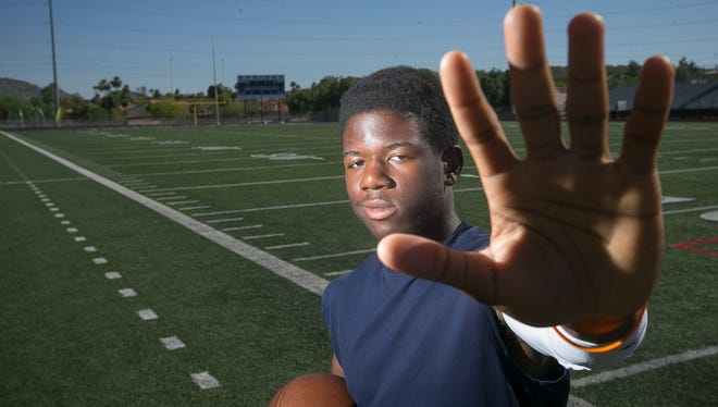 Phoenix North Canyon wide receiver John Okwoli is a three-sport athlete who is quietly showing his football prowess and racking up offers.