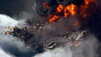 In this April 21, 2010, file aerial photo, the Deepwater Horizon oil rig burns in the Gulf of Mexico more than 50 miles southeast of Venice, La. Five years after the explosion, there have been enhancements to oil rig safety.