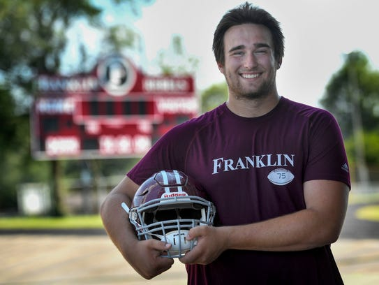 Franklin High School offensive lineman Max Wray poses