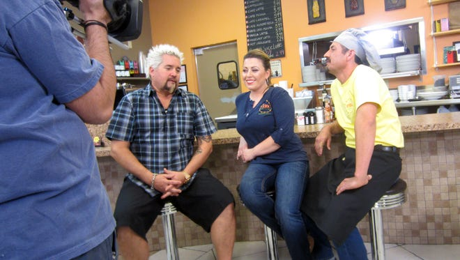 (From left) Guy Fieri, Perk Eatery owner Pauline Martinez and her husband/co-owner, Carmen Martinez.