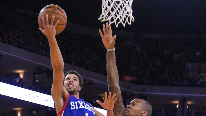 Philadelphia 76ers guard Michael Carter-Williams (1) shoots a layup against Golden State Warriors forward Marreese Speights (5) during the second quarter at Oracle Arena.