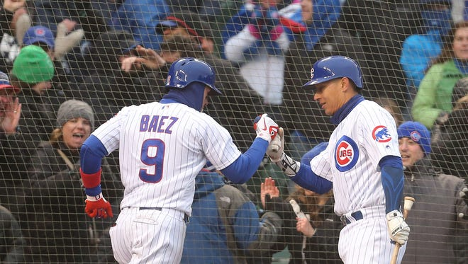 Apr 14, 2018; Chicago, IL, USA; Chicago Cubs second baseman Javier Baez (9) is congratulated for scoring a run by first baseman Efren Navarro (50) during the eighth inning against the Atlanta Braves at Wrigley Field. Chicago won 14-10. Mandatory Credit: Dennis Wierzbicki-USA TODAY Sports