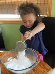 Merah Reed proves that kids love to help measure things for cooking.