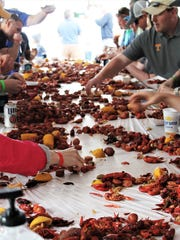 Several hundred people show up each year for a crawfish boil fundraiser at McCabe Pub in honor of one of its owners, Stefanie Dean Brown, who is battling LAM disease. This picture is from the 2014 event.