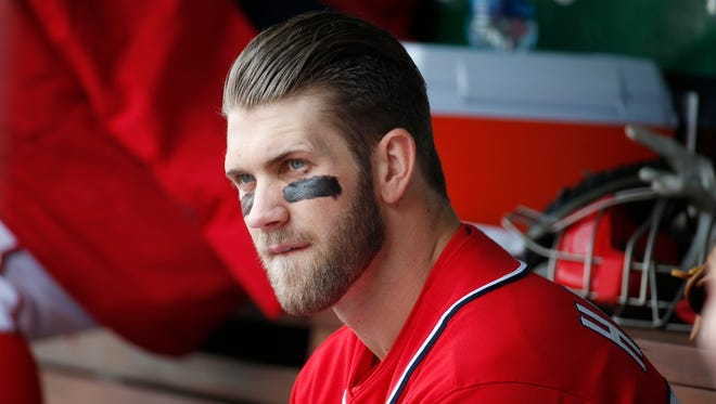The Nationals' Bryce Harper sits on the bench during the fourth inning Saturday against St. Louis.