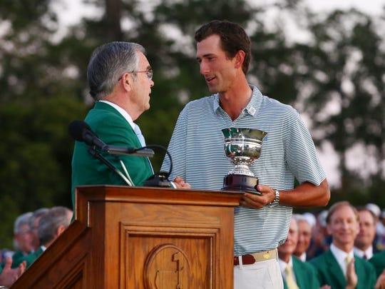 Augusta National Golf Club Chairman William Payne presents