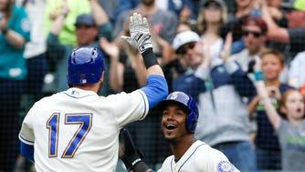 May 20, 2018; Seattle, WA, USA; Seattle Mariners shortstop Jean Segura (2) celebrates with right fielder Mitch Haniger (17) his two run home run against the Detroit Tigers during the ninth inning at Safeco Field.