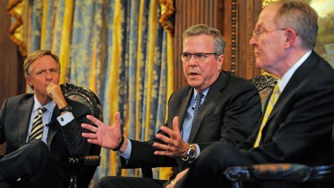 Former Florida Gov. Jeb Bush takes part in an open conversation with Sen. Lamar Alexander and Gov. Bill Haslam at the Hermitage Hotel. Wednesday March 19, 2014, in Nashville, TN.