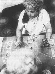 Psychic Rev. Louise Morgan reads tarot cards at the