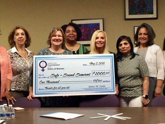 Joelle Piercy of Safe+Sound Somerset accepts a ceremonial check from the Somerset County Commission on the Status of Women. Commission members pictured with her (left to right), are Vaseem Firdaus, Marti Kalko, Beverly Briggs-Lawson, Chair Janice Fields, Smriti Agrawal, Stella Ayala and Aparna Virman.