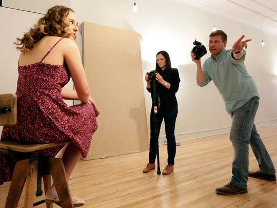 Professional photographers Kelsy and Butch McCartney direct and photograph Emma Walters during a session Tuesday at The McCartneys Photography in downtown Wausau.