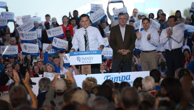 Mitt Romney campaigns in October 2012 in Tampa with former Florida governor Jeb Bush and Sen. Marco Rubio, right.