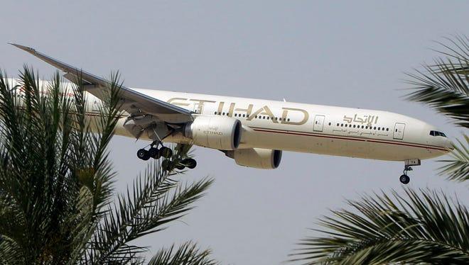 An Etihad Airways plane prepares to land in Abu Dhabi Airport, United Arab Emirates, on April 1.