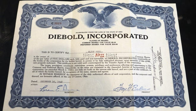 """This photo taken Friday, June 12, 2015, shows a Diebold stock certificate in the name of Elliot Ness, in Fort Lauderdale, Fla. Eliot Ness, the famed Prohibition agent who led the """"Untouchables"""" in their crusade against Chicago gangster Al Caponeís liquor bootlegging rackets, later became the top executive at bank services company Diebold Inc."""