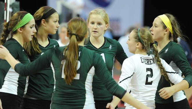 D.C. Everest players Natalie Mohring (11), Allyssa Frahm (2),  and Emily Bauman (12) console their team after losing to DSHA in WIAA 2015 State Girls Volleyball at the Resch Center in Green Bay Thursday.