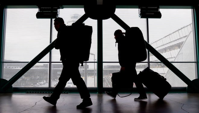 Travelers walk to a ticketing desk at O'Hare International Airport in Chicago on Dec. 21, 2012.