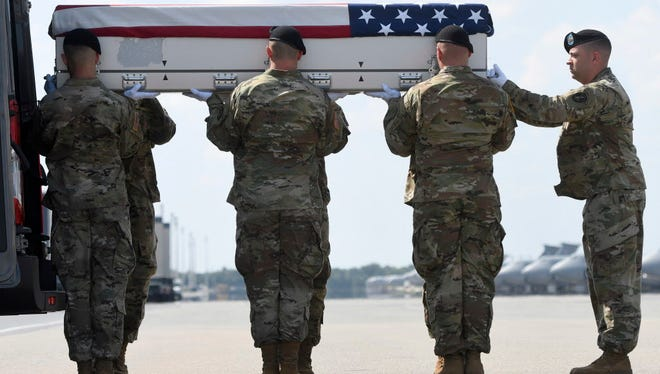 The remains of Sgt. Jonathon Hunter arrive at the Air Force base in Delaware on Aug. 4, 2017.