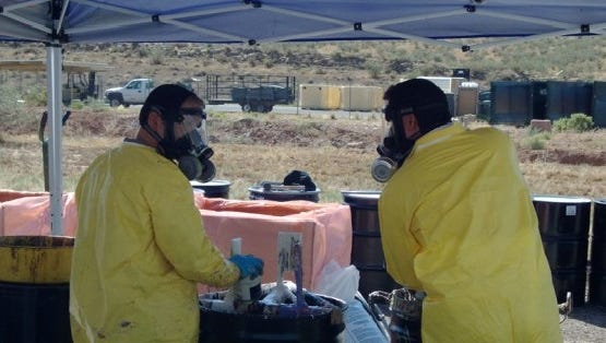 Waste disposal teams handle household hazardous materials brought in by residents during a disposal event at the Washington County Solid Waste District landfill last year.