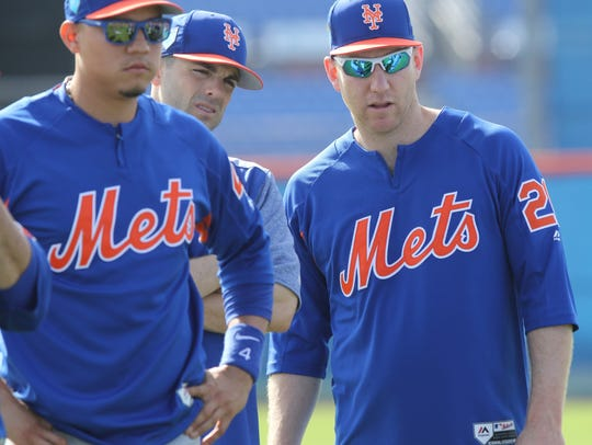 Wilmer Flores, David Wright and Todd Frazier listen to manager Mickey Callaway before they started their infield drills during Spring Training 2018.