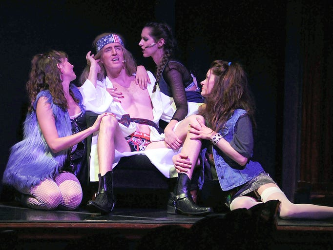 Kyle Szen as Stacee Jaxx is surrounded by women in