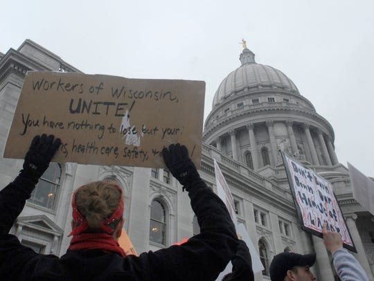 Protesters demonstrate against Gov. Scott Walker's