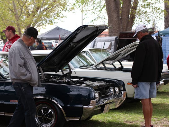 Car fanatics of all ages gather to view the work and