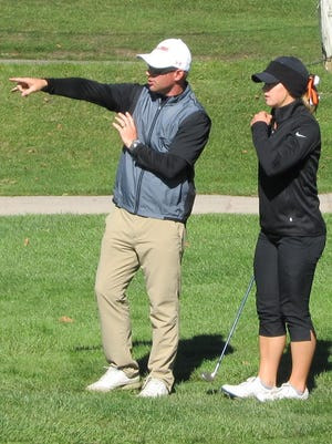 Brighton coach Paul Parsell gives a tip to Annie Pietila on the final hole of the KLAA Association golf tournament on Monday.