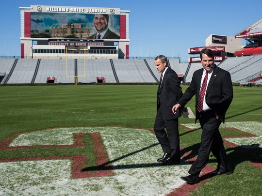 South Carolina coach Will Muschamp, right, and assistant