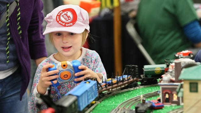 Kira Klein of Brookfield lines up a photo at the 2016 Trainfest. The 2017 edition of what's billed as America's largest operating model railroad show runs Friday and Saturday at State Fair Park.