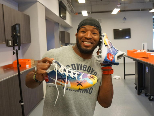Pensacola native Alfred Morris shows off his custom