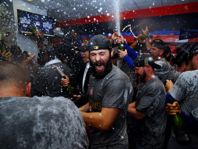 bc8840ff15f Cubs celebrate first World Series title since 1908. Cubs pitcher Jake  Arrieta ...