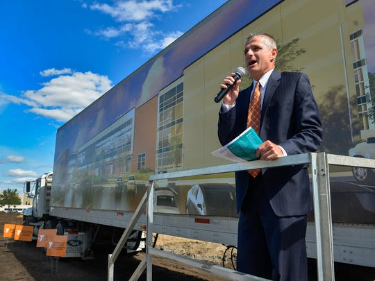 Greg Gack, YMCA executive director, speaks during a brief wall raising ceremony Tuesday, June 7, at the new St. Cloud Area YMCA Community & Aquatics Center site in Whitney Park.