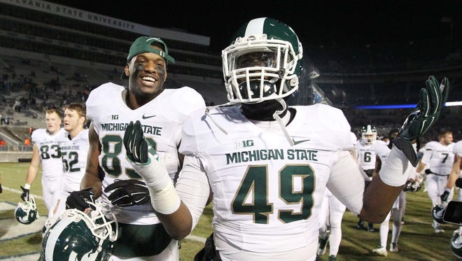 Nov 29, 2014; Michigan State Spartans linebacker Shane Jones (49) and defensive end Shilique Calhoun (89) react following the completion of the game against the Penn State Nittany Lions at Beaver Stadium.