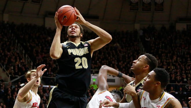 Purdue center A.J. Hammons (20) shoots between Maryland forwards Jake Layman, left, and Jared Nickens, right, Maryland center Diamond Stone, center, and Purdue forward Vince Edwards, second from right, in the second half of an NCAA college basketball game, Saturday, Feb. 27, 2016, in West Lafayette, Ind.