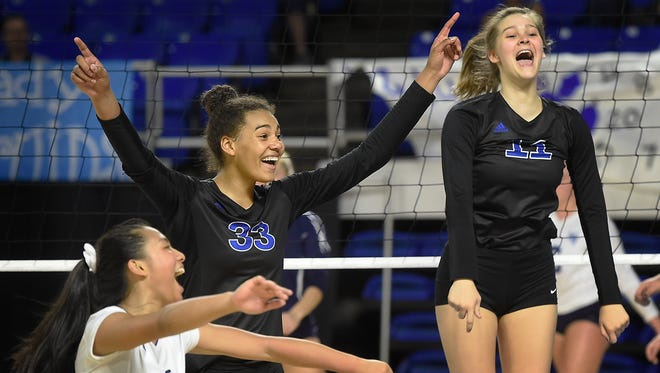 Brentwood players Andrea Acevedo (6), Logan Eggleston (33) and Celia Lamb (11) celebrate their win over Hardin Valley at MTSU's Murphy Center during the TSSAA volleyball state tournament on Oct. 20, 2016.  Thursday Oct. 20, 2016, in Murfreesboro, Tenn.
