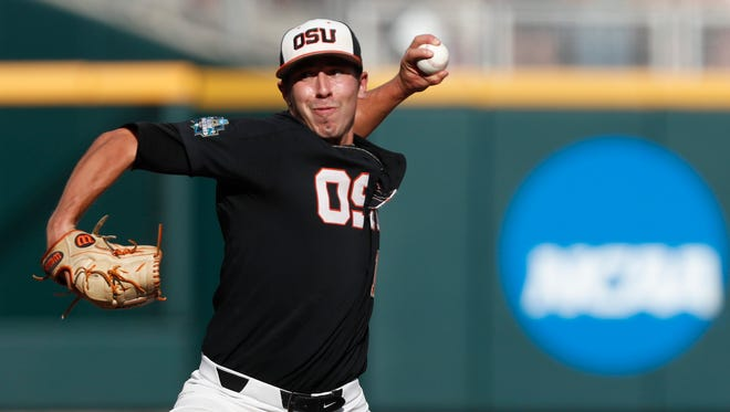 Jun 26, 2018; Omaha, NE, USA; Oregon State Beavers pitcher Luke Heimlich (15) pitches against the Arkansas Razorbacks in the first inning in game one of the championship series of the College World Series at TD Ameritrade Park. Mandatory Credit: Bruce Thorson-USA TODAY Sports