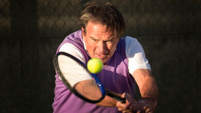 Jimmy Connors returns the ball to Aaron Krickstein in Boca Raton, Fla., Tuesday, Feb. 10, 2015. Connors played in a private exhibition against Aaron Krickstein, his opponent in a memorable match at the U.S. Open more than 23 years ago. (AP Photo/J Pat Carter)                                                  ORG XMIT: FLJC110