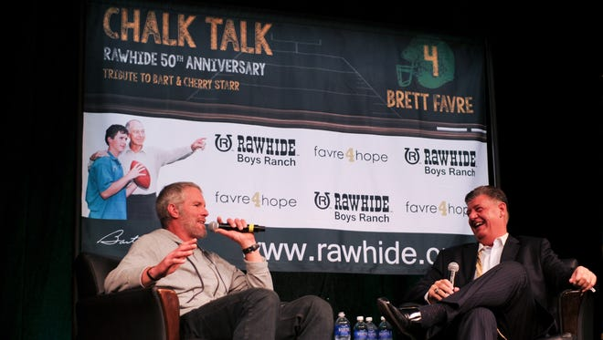 Longtime Milwaukee sports-talk radio host Bill Michaels, shown at right with Brett Favre at a 2015 event in Green Bay, is out as a midday host at WSSP-AM (1250), also known as The Fan.