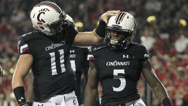 Bearcats quarterback Gunner Kiel congratulates running back Mike Boone after Boone scored in a game last September against Alabama A&M. UC is seeking to join the Big 12 Conference.