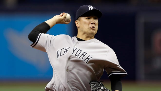 New York Yankees' Masahiro Tanaka, of Japan, pitches to the Tampa Bay Rays during the first inning of a baseball game Wednesday, Sept. 21, 2016, in St. Petersburg, Fla.