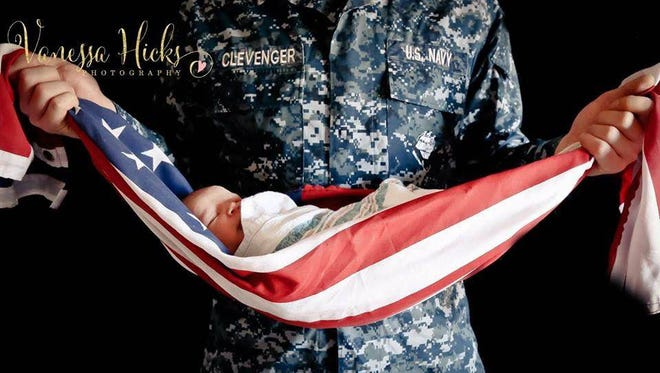This photo of a newborn in an American flag taken by Virginia Beach, Va., photographer Vanessa Hicks is sparking controversy over whether it violates U.S. flag code.
