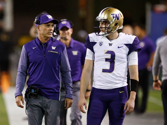 Washington coach Chris Peterson, left, talks with quarterback Jake Browning (3) during the first half of an NCAA college football game against Arizona State on Saturday, Oct. 14, 2017, in Tempe, Ariz. (AP Photo/Ross D. Franklin)