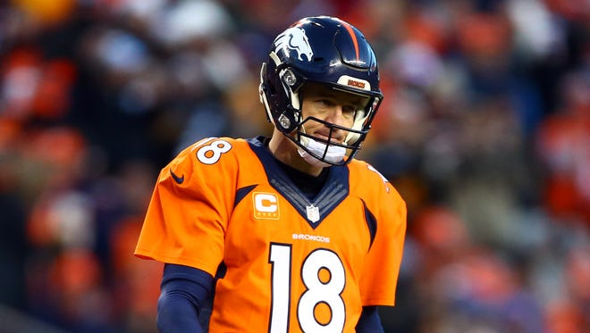 Denver Broncos quarterback Peyton Manning (18) reacts during the third quarter of the AFC Divisional round playoff game against the Pittsburgh Steelers at Sports Authority Field at Mile High.