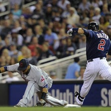 MINNEAPOLIS, MN - SEPTEMBER 19: Brian Dozier #2 of the Minnesota Twins is out at second base as Carlos Santana #41 of the Cleveland Indians fields the ball during the first inning of the game on September 19, 2014 at Target Field in Minneapolis, Minnesota. (Photo by Hannah Foslien/Getty Images)