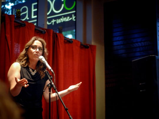 Megan Finnerty's clever wit entertains the audience during the Arizona Storytellers Project at La Bocca Pizzeria in Tempe on Monday July 22, 2013.