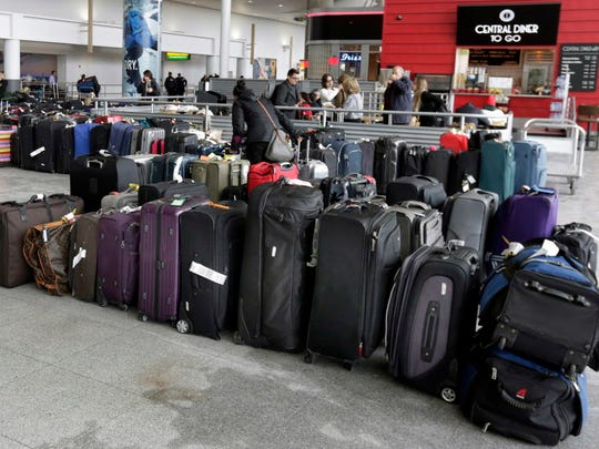 Unclaimed baggage sits Jan. 8, 2018, at New York's John F. Kennedy Airport. In July 2016, Congress mandated airlines refund bag fees if luggage arrives late, but the regulation has been delayed after President Trump ordered a regulatory freeze on his first day in office.