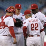 Philadelphia Phillies pitcher Jerad Eickhoff, center, allowed four runs in 5 2/3 innings against the New York Mets on Wednesday night.