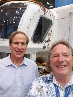 Elmira native Mark Zito, right, stands in front of a Mars Rover prototype with astronaut Mike Gernheardt, the first man to do a space walk from the space station.